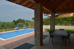 The swimming pool at or close to Villa Artemia