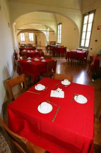 A restaurant or other place to eat at Student's Hostel Della Ghiara