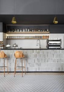 A kitchen or kitchenette at Boro Hotel