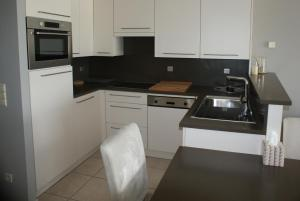 Cuisine ou kitchenette dans l'établissement Apartment Bredene