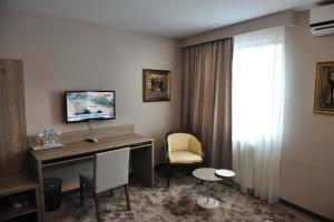 A television and/or entertainment center at Hotel VIP