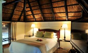 A bed or beds in a room at Cresta Marang Gardens Hotel