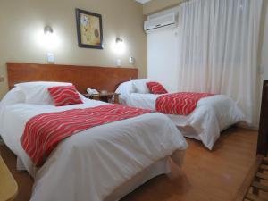 Кровать или кровати в номере Grand Hotel