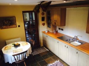 A kitchen or kitchenette at Low Nook Farm Holiday Cottage