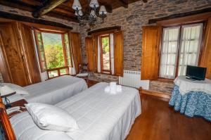 Cama o camas de una habitación en El Capricho de Josana