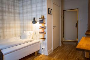 A bed or beds in a room at Continental Apartment Hotel Sundsvall