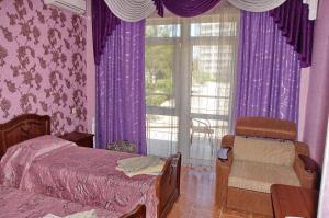 Кровать или кровати в номере Тихая гавань Гостевой дом