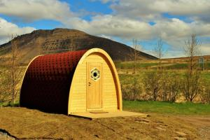 A garden outside Fossatun Camping Pods & Cottages - Sleeping Bag Accommodation