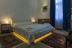 Кровать или кровати в номере E&E Apartments