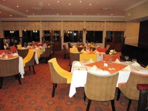 A restaurant or other place to eat at Phakalane Golf Estate Hotel Resort