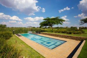 The swimming pool at or near Phakalane Golf Estate Hotel Resort