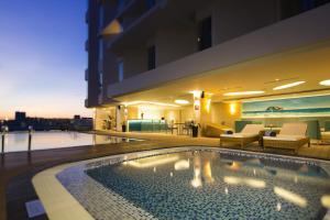 The swimming pool at or near Liberty Central Nha Trang Hotel