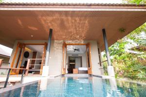 The swimming pool at or near GUTI Resort by AKA Hua Hin
