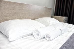 Кровать или кровати в номере IT Time Hotel