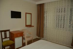 A bed or beds in a room at Hotel Luna Piena
