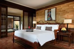 A bed or beds in a room at Tanah Gajah, a Resort by Hadiprana