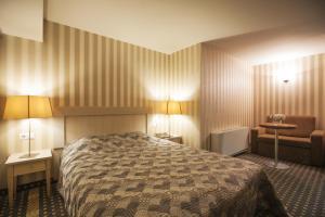 Lova arba lovos apgyvendinimo įstaigoje Nesė Pramogų Bankas Guest House