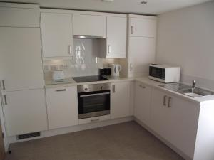 A kitchen or kitchenette at 6B Church St. Dingwall Apartment