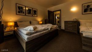 A bed or beds in a room at Mucha Apartments