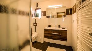 A bathroom at Mucha Apartments