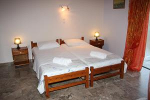 A bed or beds in a room at Olympion Village Studios