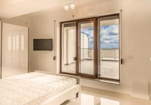 Un pat sau paturi într-o cameră la Apartment Mirage 44