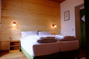 Letto o letti in una camera di Rifugio Soldanella