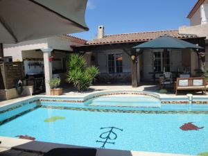 The swimming pool at or near Villa Lombrine