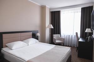 Кровать или кровати в номере Отель Азия
