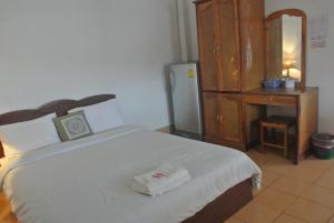 A bed or beds in a room at Nice Guesthouse