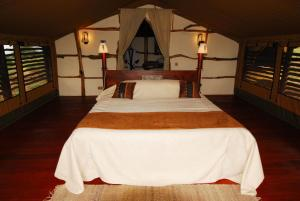 A bed or beds in a room at Satao Elerai