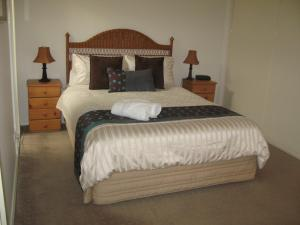 A bed or beds in a room at The Villa Kyabram