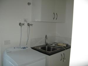 A kitchen or kitchenette at The Villa Kyabram