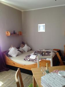A bed or beds in a room at Haus Silbertal am Waldfreibad