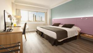 Ein Bett oder Betten in einem Zimmer der Unterkunft Hotel Chamartin The One