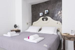 Un ou plusieurs lits dans un hébergement de l'établissement Ambition Suites