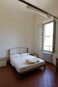 A bed or beds in a room at Student's Hostel Della Ghiara