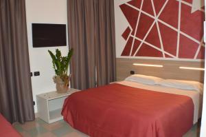 Letto o letti in una camera di Sempione Hotel Malpensa