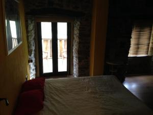 Uma cama ou camas num quarto em Casa Rural Doiras