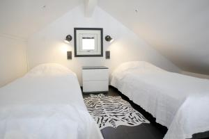 Säng eller sängar i ett rum på Dragsö Camping & Stugby
