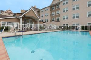 The swimming pool at or near Residence Inn Baton Rouge Towne Center at Cedar Lodge