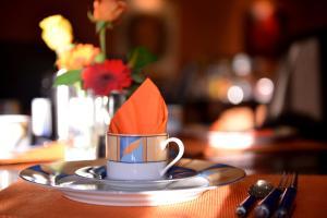 Ein Restaurant oder anderes Speiselokal in der Unterkunft Alpha-Hotel garni