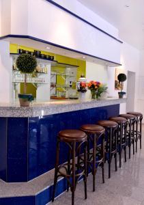Lounge oder Bar in der Unterkunft Alpha-Hotel garni