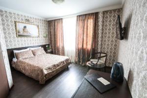 Кровать или кровати в номере Фортуна Отель Митино