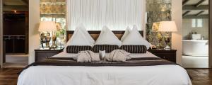 מיטה או מיטות בחדר ב-Le Vallon de Valrugues & Spa