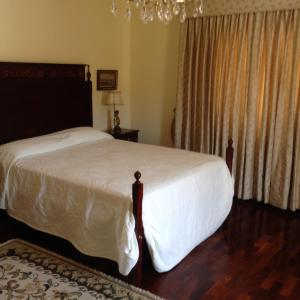 A bed or beds in a room at Quinta de Santo António