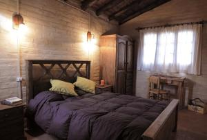 A bed or beds in a room at Las Margaritas