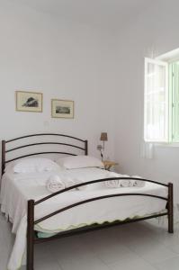 Ένα ή περισσότερα κρεβάτια σε δωμάτιο στο Georgias House