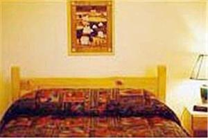 A bed or beds in a room at Cabot Trail Sea & Golf Chalets