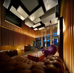 The lobby or reception area at G Hotel Kelawai